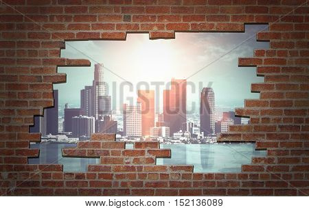 Broken red brick wall with city view. Freedom concept
