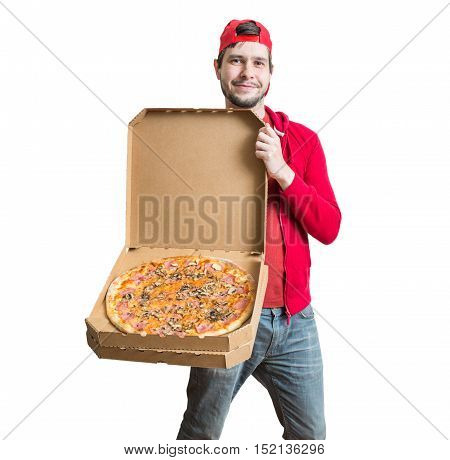 Pizza delivery concept. Young man is showing tasty pizza in box. Isolated on white background.