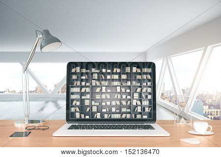 Workplace with coffee cup lamp other items and abstract bookshelf on laptop screen. E-book and online library concept. 3D Rendering