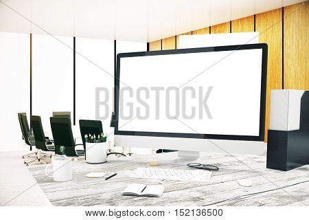 Closeup of blank white computer screen placed on wooden office desktop with supplies and other items. Mock up 3D Rendering