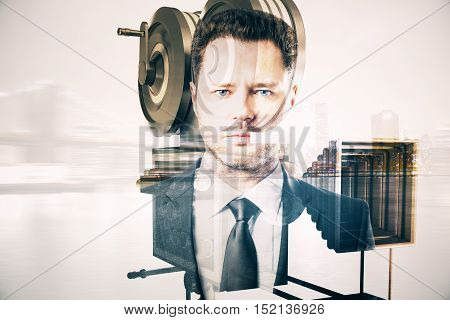 Handsome young businessman and old style movie camera on city background. Double exposure