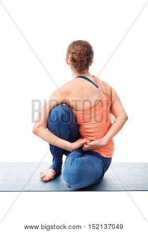 Woman doing Ashtanga Vinyasa Yoga stretching  asana Marichyasana D - pose posture dedicated to sage Marichi on white background