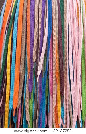 Collection of many colorful shoelaces at a retail stand