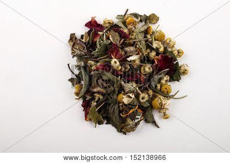 organic summery herbal blossom tea on white background