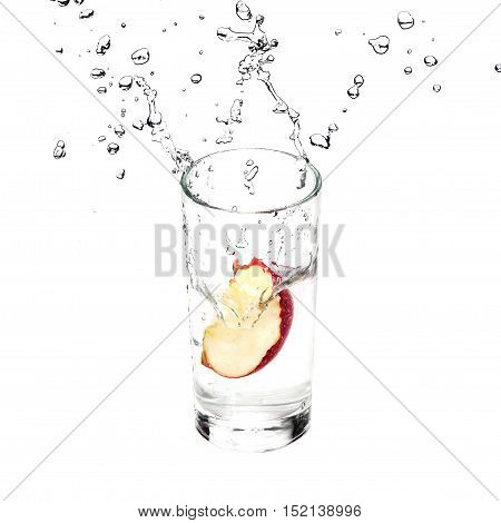 Fresh Apple is splashing in glass with pure water isolated on white background.