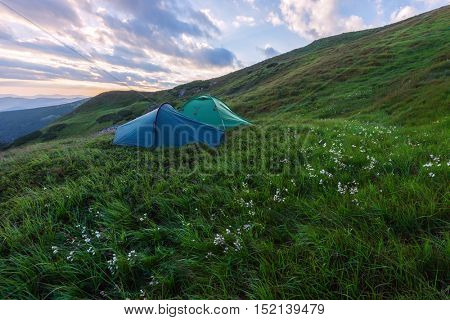 two tents on mountains closeup