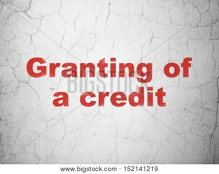 Banking concept: Red Granting of A credit on textured concrete wall background