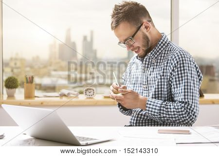 Sideview Of Young Businessman Taking Notes
