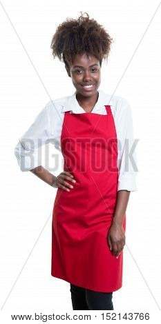 Beautiful african american waitress with curly hair and red apron on an isolated white background for cut out