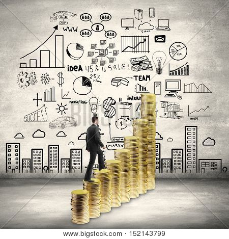 Side view of businessman in suit climbing abstract golden coin ladder on concrete wall background with business sketch. Success concept