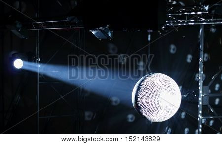 Discotheque mirror ball with pin spots and haze stock photo