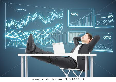 Side view of relaxing businessman looking at abstract digital business charts on grey background. Financial growth concept