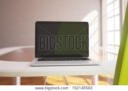 Closeup of empty laptop display on white desktop in modern interior with sunlight. Mock up 3D Rendering