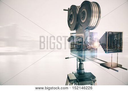 Retro movie camera on abstract city background with copy space. Double exposure. Cinema concept