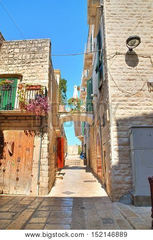 Image of an alleyway of Molfetta. Puglia. Italy.