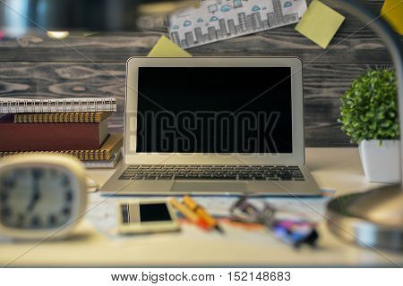Desktop With Laptop And Blurry Objects