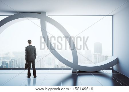 Back view of businessman in modern interior with city view and daylight. 3D Rendering