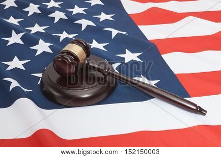 Studio Shot Of Judge Gavel And Soundboard Laying Over Usa Flag