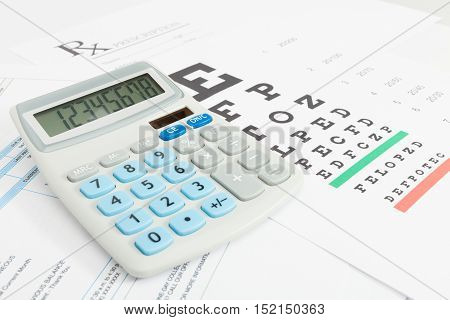 Eyesight test table and medical prescription form with calculator over it series