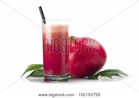 a glass of pomegranate juice on white background