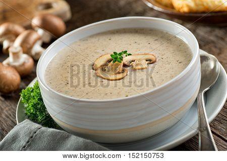 A bowl of delicious homemade cream of mushroom soup.