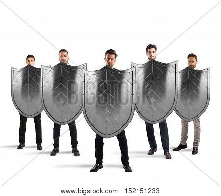 Businessmen with shields. concept of protection and defense in the business world