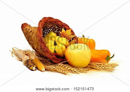 Thanksgiving Cornucopia With Yellow Theme Fruit And Vegetables Isolated On A White Background