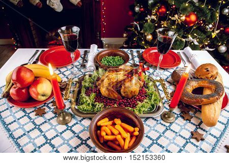 Christmas Dinner By Candlelight, Table Setting. Thanksgiving Table With Baked Turkey In A Decorated
