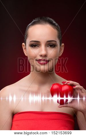 Woman in romantic concept with red heart