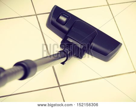 Sweeping housework technology device domestic concept. Vacuum cleaner extension tube. Part of hoover cleaning floor.