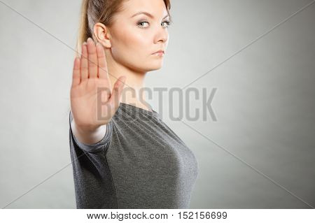 Female Shows Stop Sign By Her Hand.