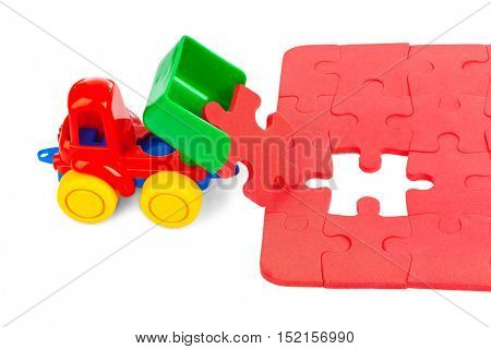 Toy truck with puzzle isolated on white background