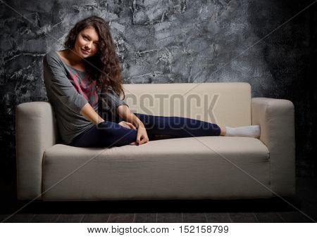 Portrait of young girl on sofa