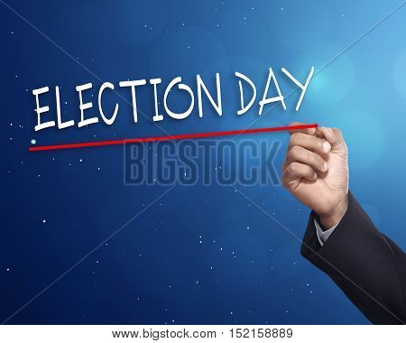 Man Hand Writing A 'election Day' With Gold Marker