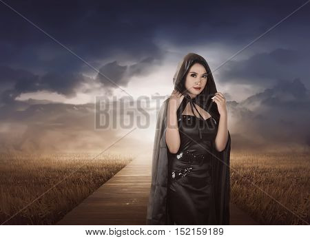 Beautiful Asian Witch Woman With Black Hood