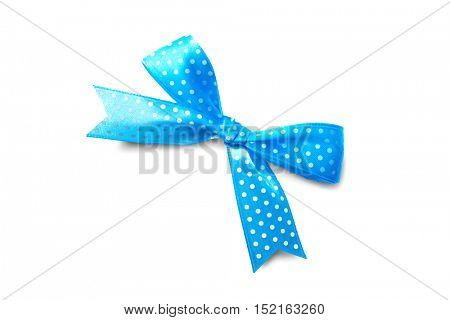 Beautiful blue bow with polka dot pattern on white background
