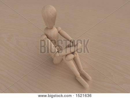Mannequin Sitting On Wood