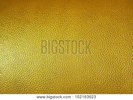 Surface of yellow leatherette texture as background