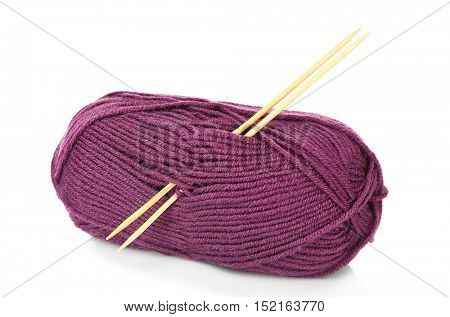 Ball of magenta knitting yarn and needles isolated on white