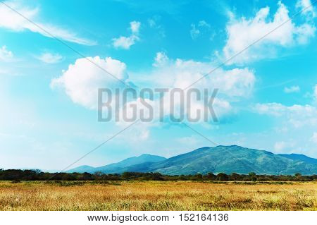 Landscape with mountain views, blue sky and beautiful clouds. Real scene without any light effects.