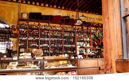 Antigua, Guatemala - June 16, 2011: Bottles of wine and alcohol lined up at the bar at Almacen Troccoli in Antigua, Guatemala. Editorial use only.