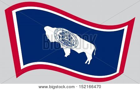 Wyomingite official flag symbol. American patriotic element. USA banner. United States of America background. Flag of the US state of Wyoming waving on gray background vector
