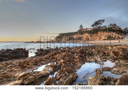 Little Corona Beach in Corona Del Mar, California at sunset in summer