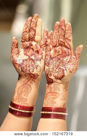 Show off two Hands Decorated with Mehandi on Women Hand