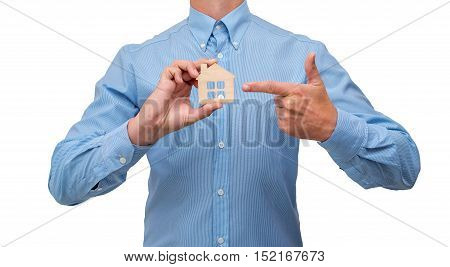man holding a symbol of house purchase