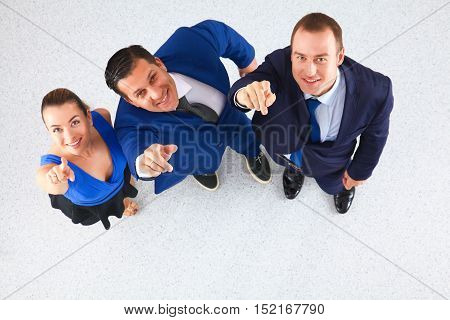 Business people standing together - pointing you on white background .