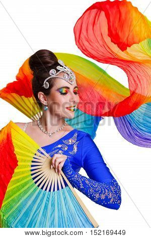 Attractive girl dancing with a colorful fan. Stage makeup.