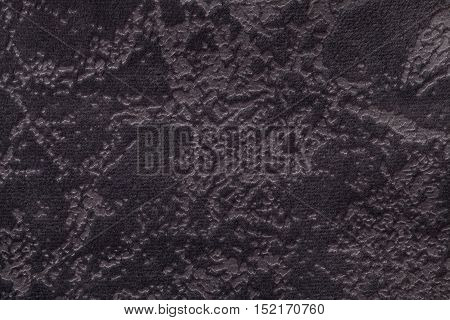 Dark brown background from a soft upholstery textile material closeup. Fabric with natural texture. Cloth backdrop.