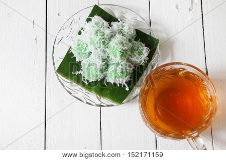 Kuih Ondeh Ondeh and tea on white wooden table