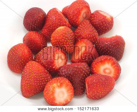 many sliced strawberries in a plate crop view
